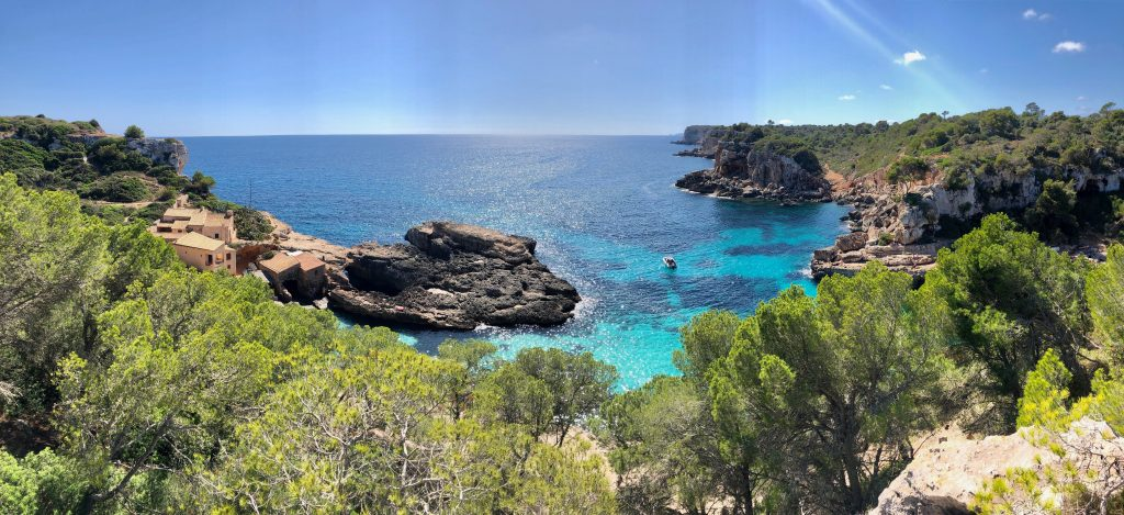 Photo of rugged landscape and shimmering sea in sunny Mallorca