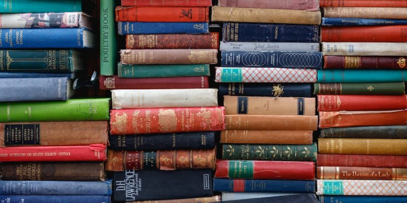 Colourful photo of stacks of historic books